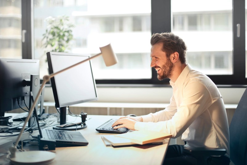 man sitting at desk in coworking space