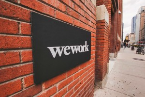 brick wall with wework sign