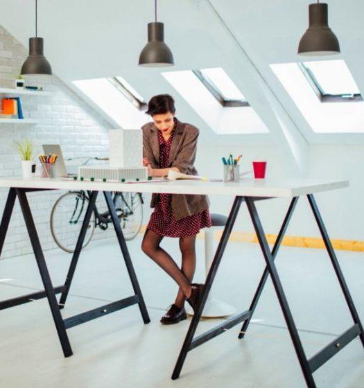 female architect at a standing desk in home office